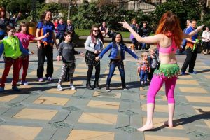 Teaching belly dancing in Peace Gardens