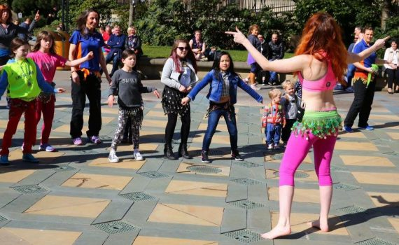 Teaching belly dancing in Peace Gardens